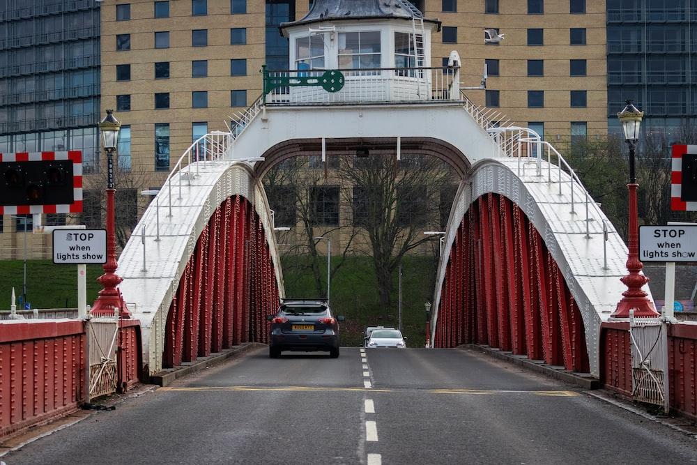 black car crossing bridge