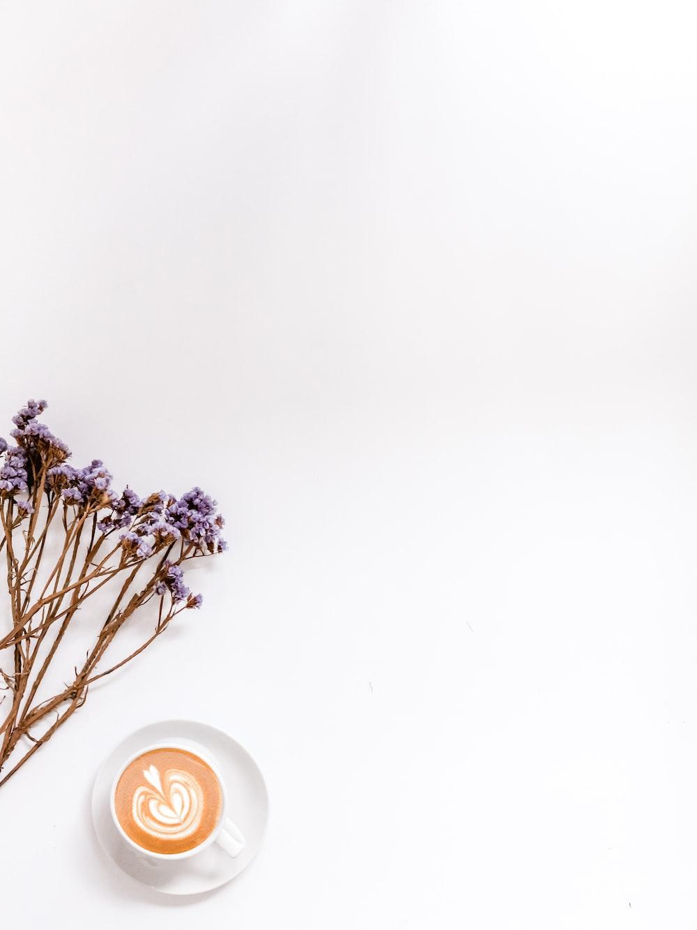flat-lay photography of latte on white mug