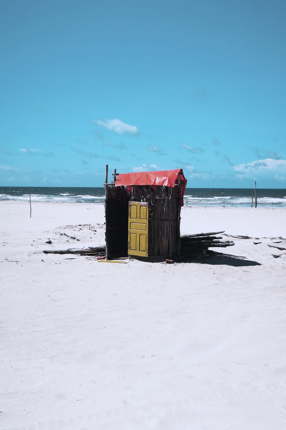 brown wooden shed on ice