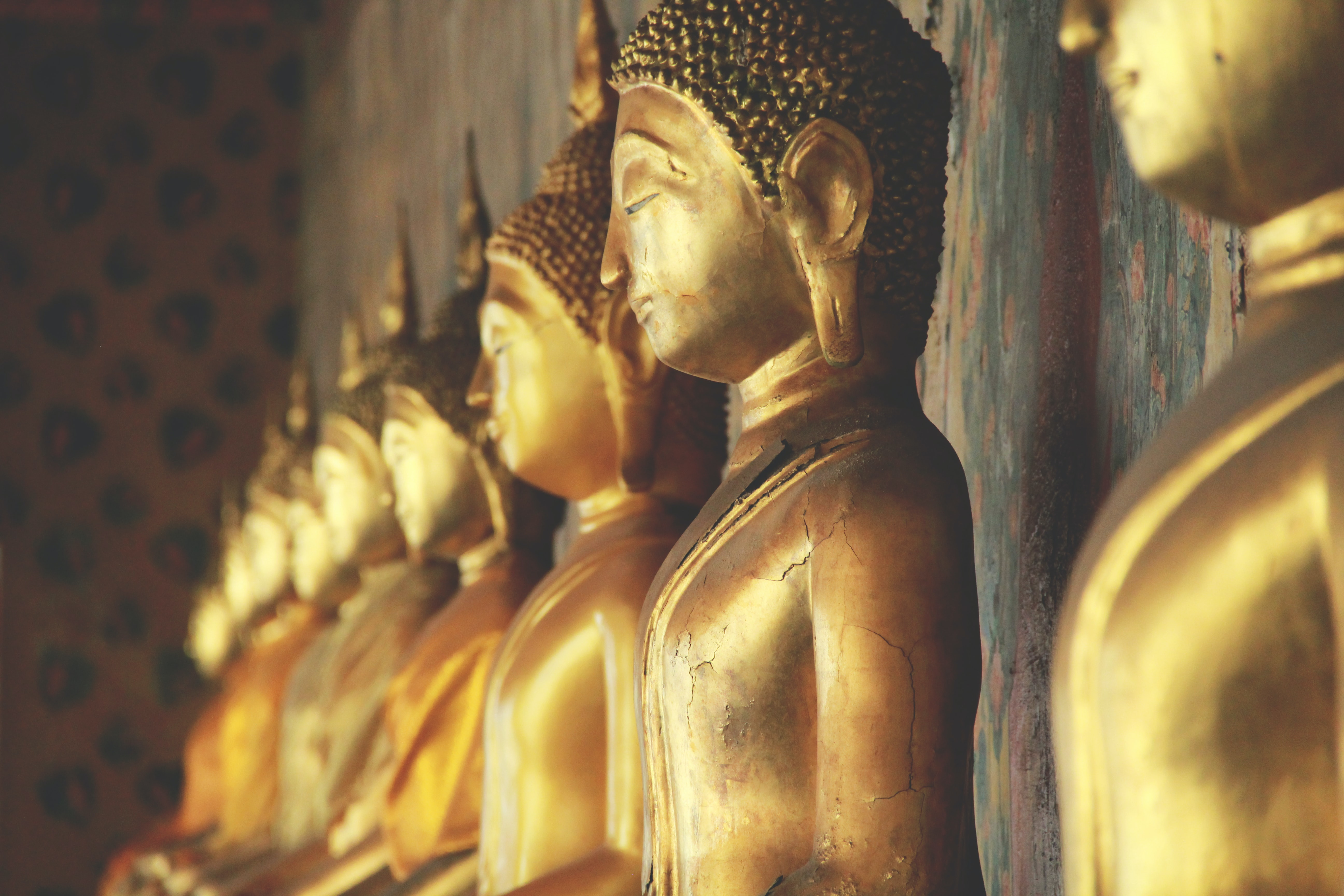 gold-colored Buddha statues