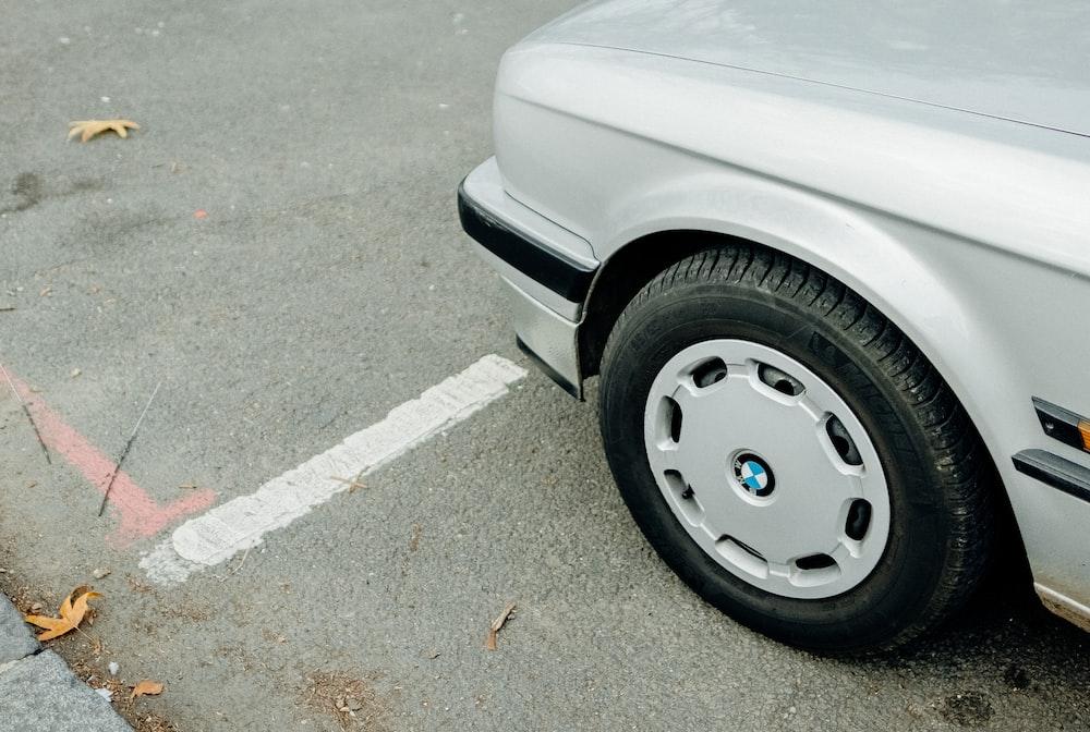 silver BMW vehicle parking during daytime