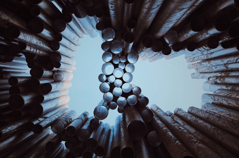 low-angle photography of metal pipes