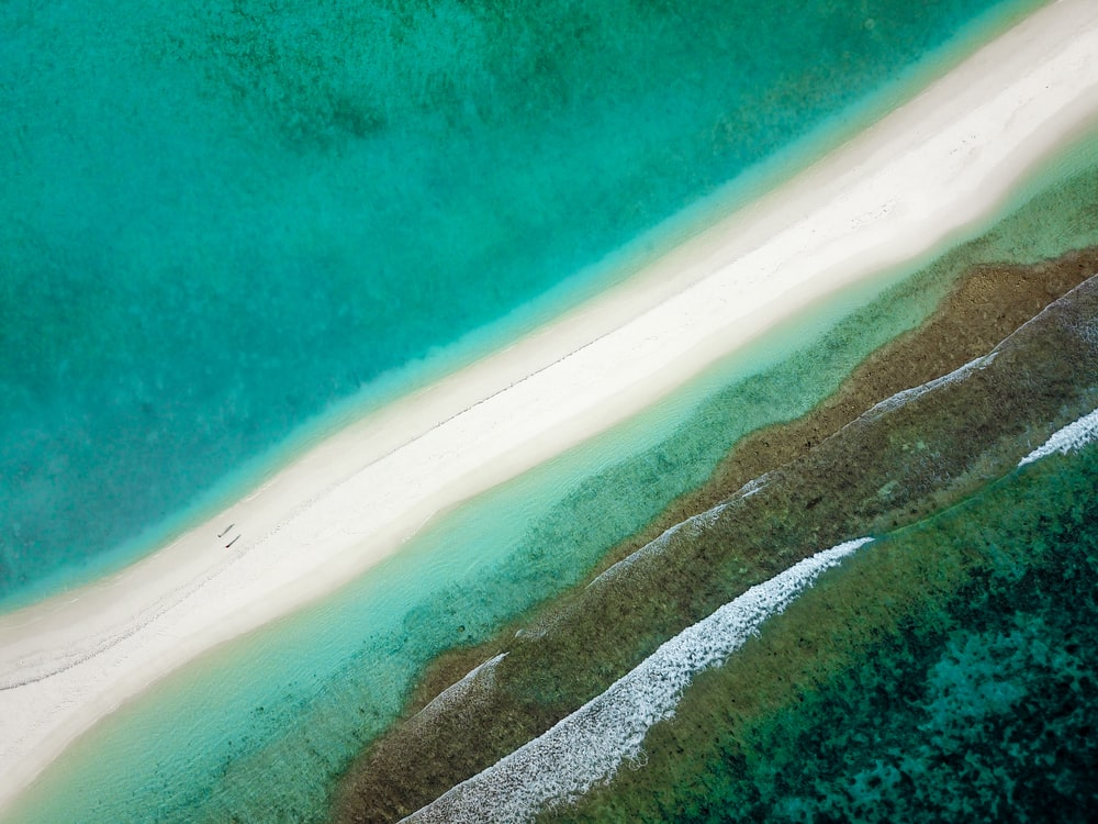 aerial photography of island beside body of water during daytime