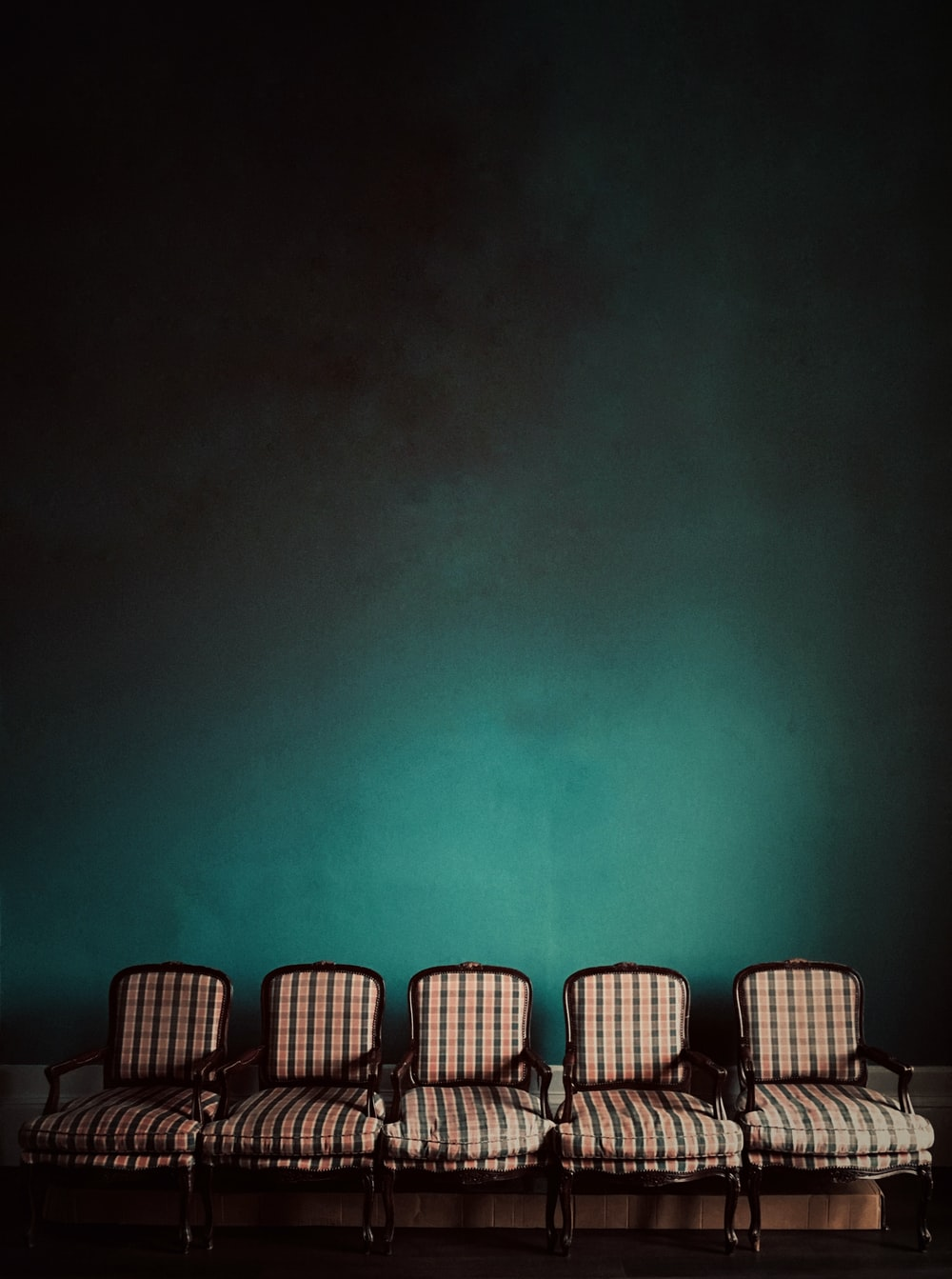 five brown armchairs