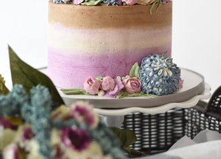 multicolored 2-tier cake on white stand