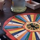 color wheel board on wooden surface