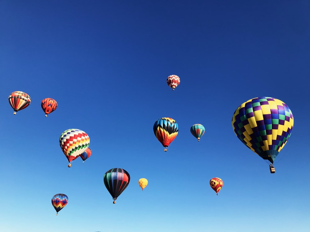 hot air balloons under blue sky during daytime