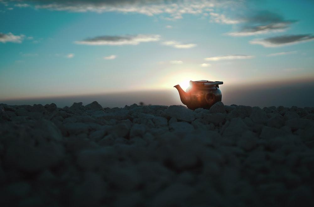 black kettle on rocks