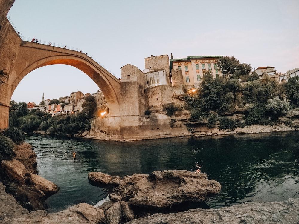 brown concrete arch bridge