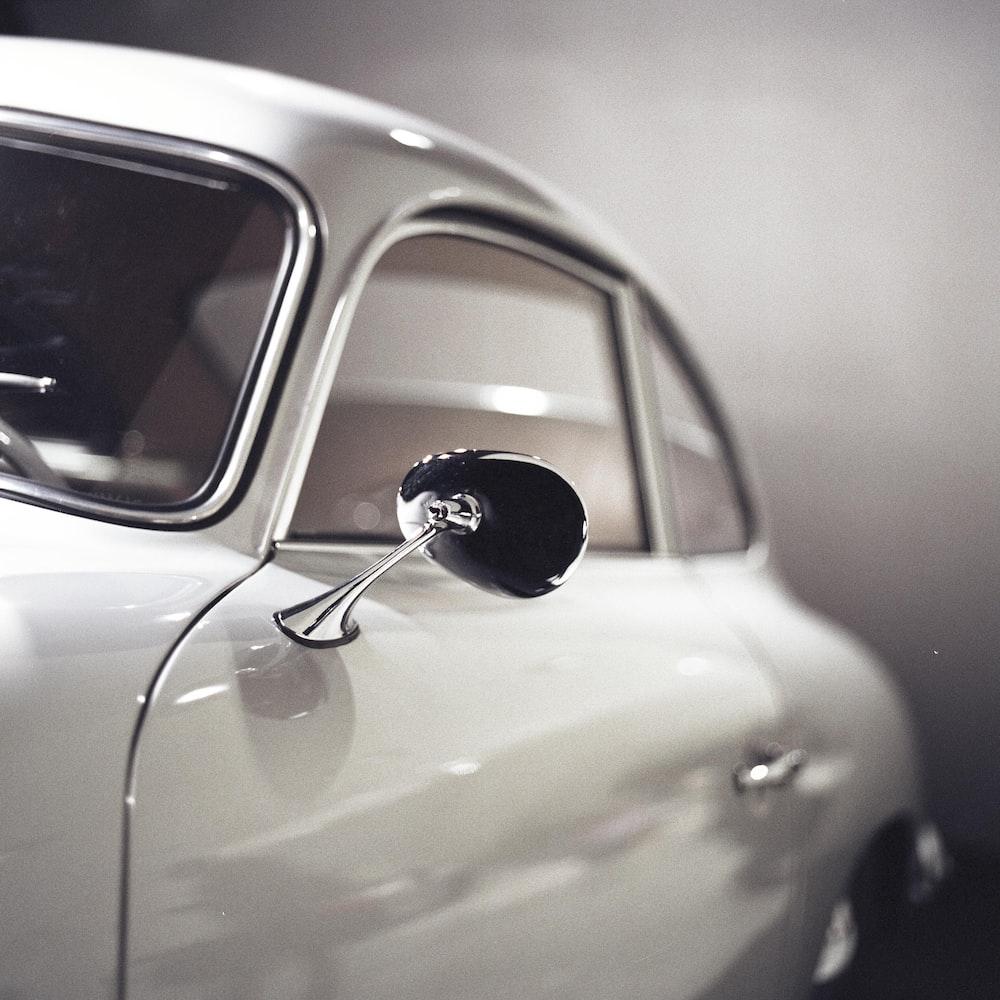 close-up photo of white 3-door hatchback
