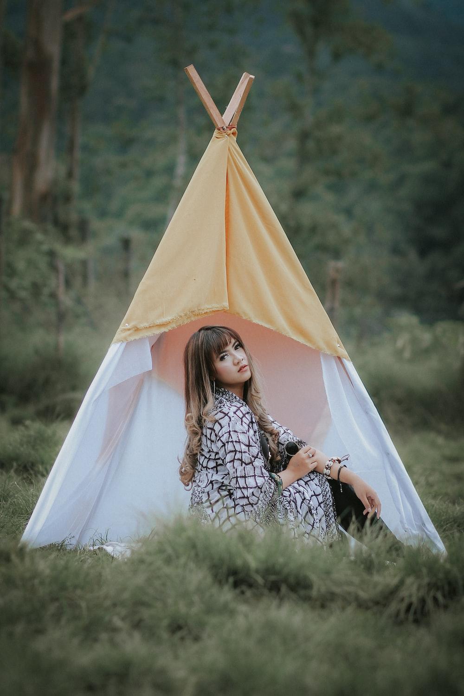 woman near teepee hut