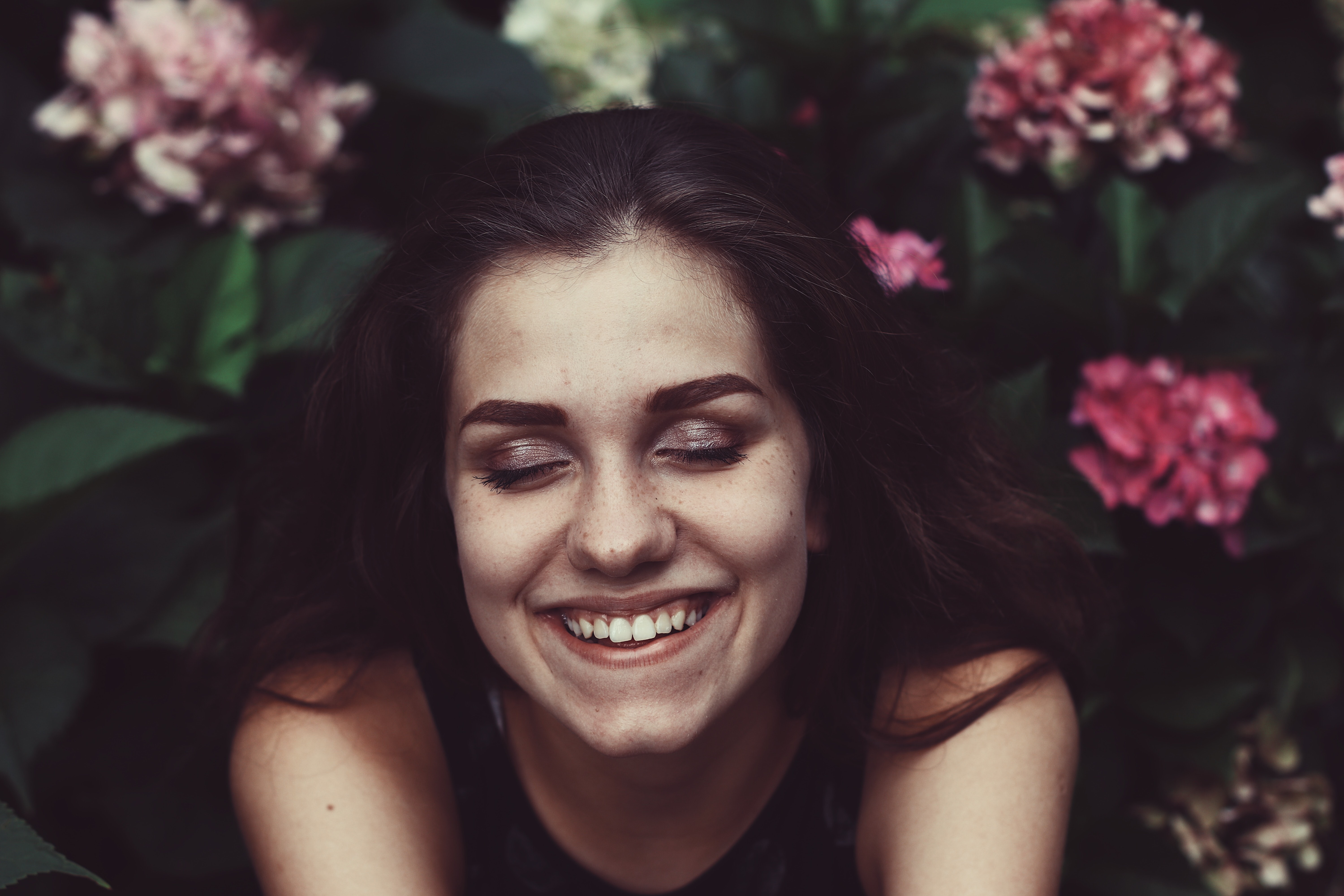 woman smiling face surrounded by flowers