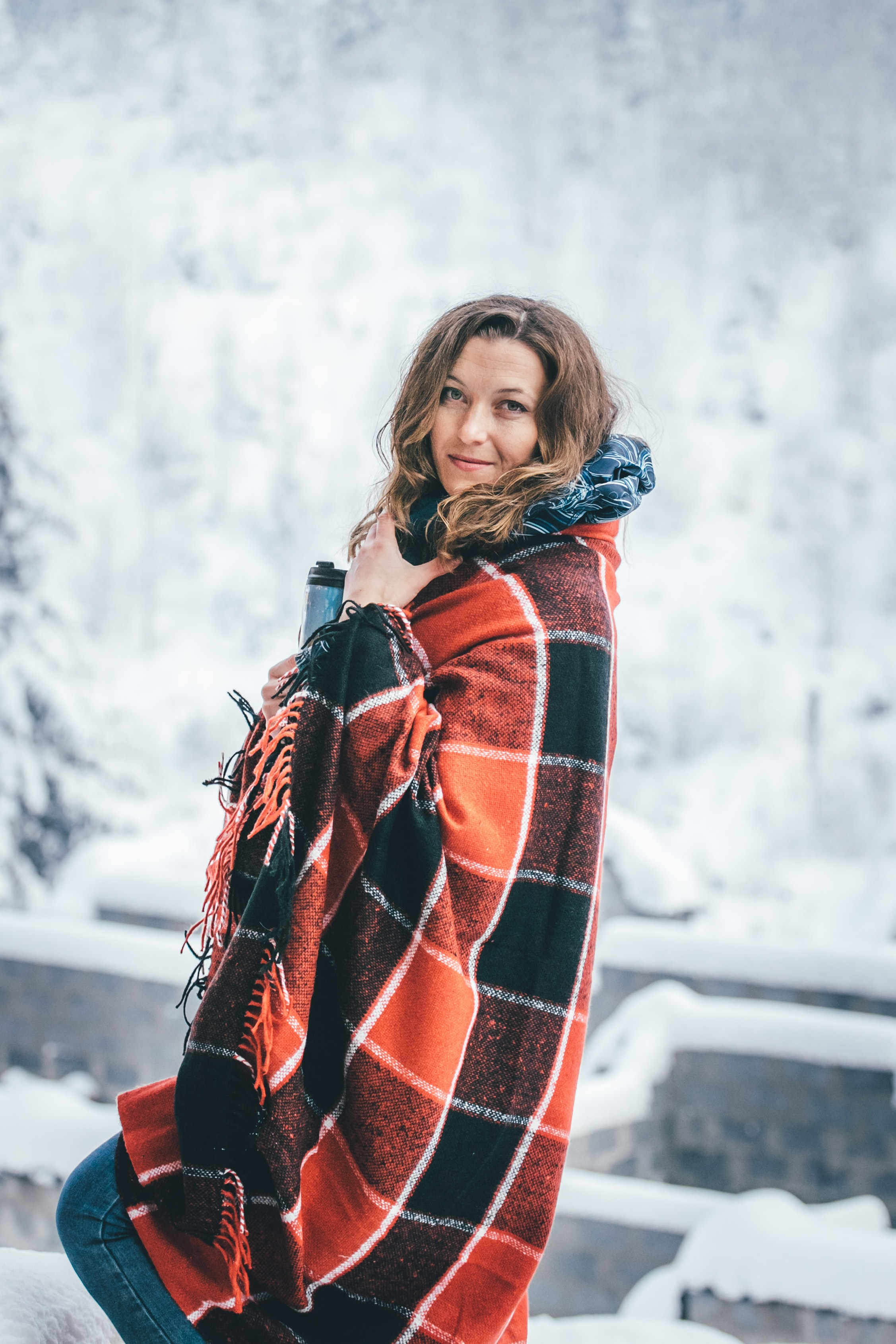 woman standing covered with blanket
