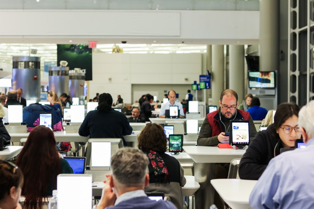 people sitting on an Airport lobby