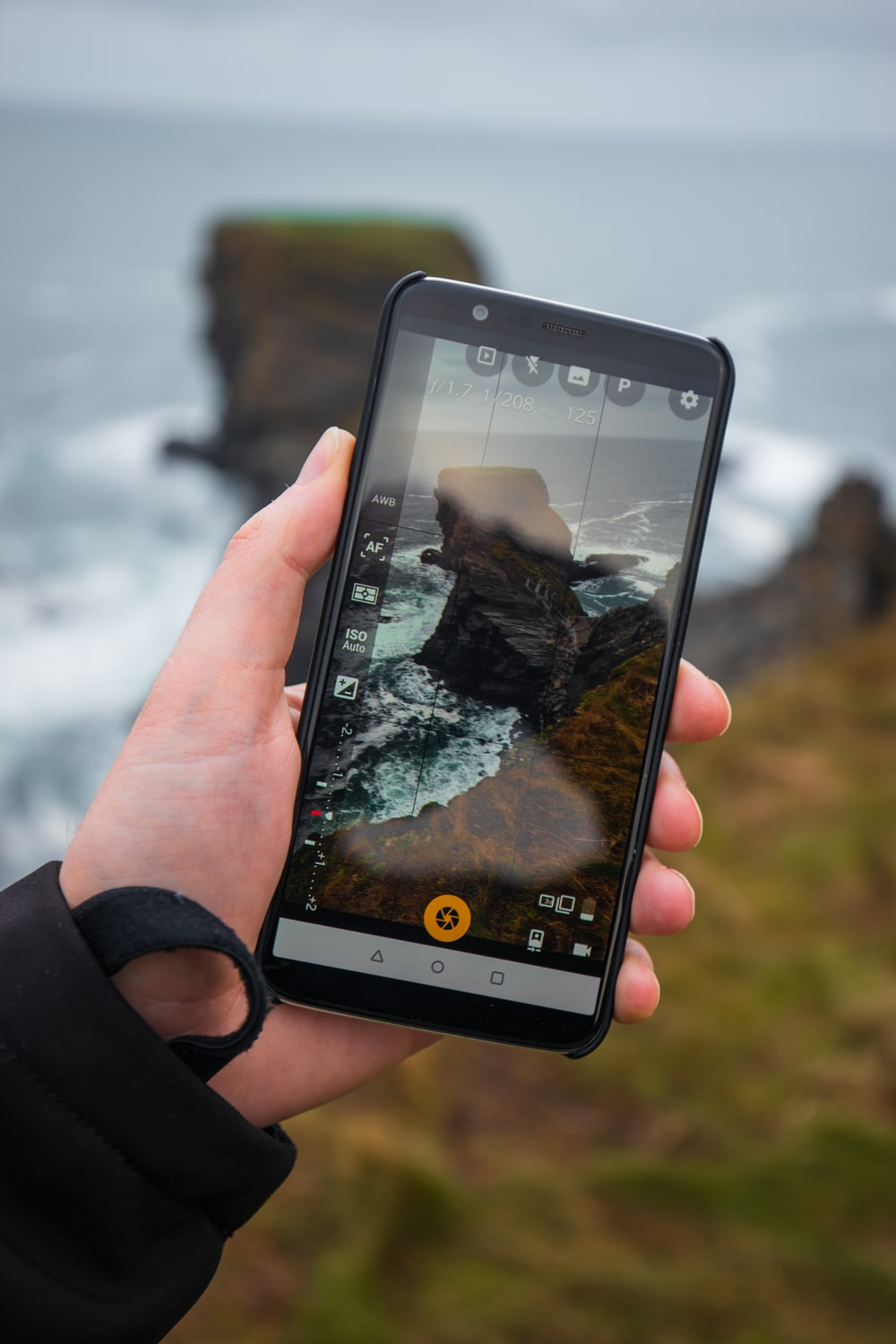 smartphone displays cliff on shore