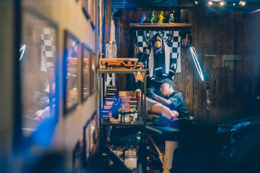 man holding tattoo machine