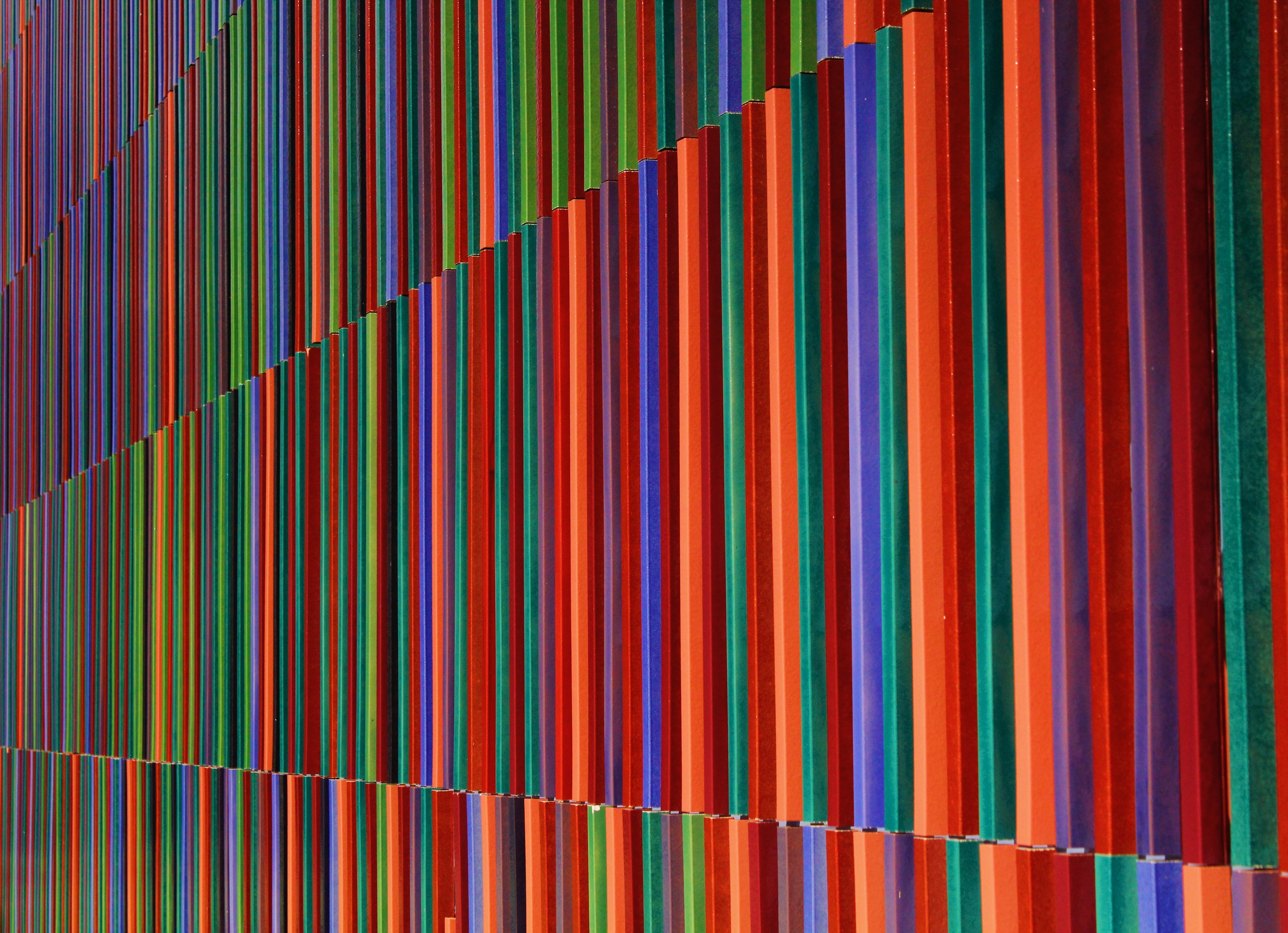 pink, blue, and yellow stripe textile
