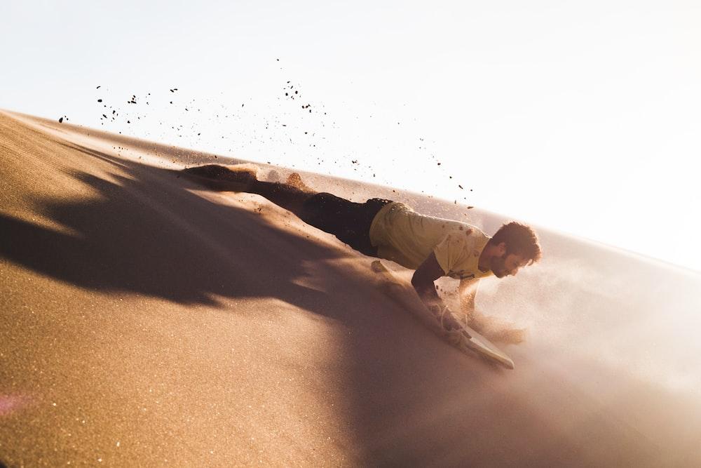 man sliding on deserted place going down