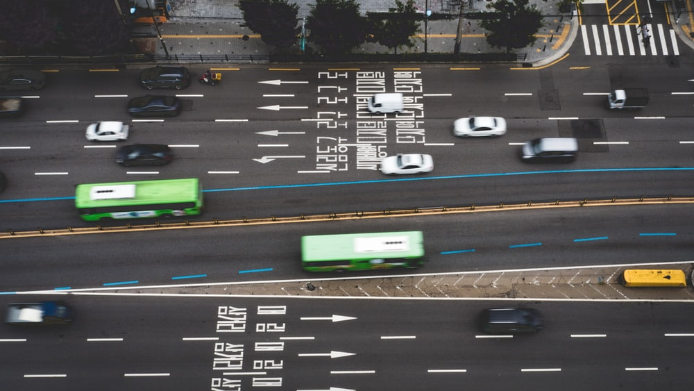 aerial view of vehicles crossing on road