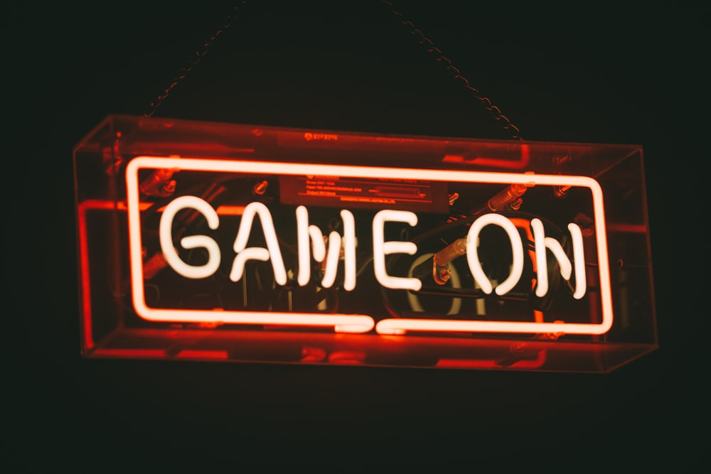 red and white Game On LED signage