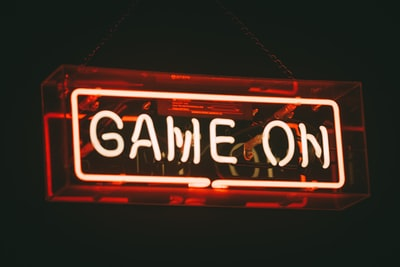 red and white game on led signage neon zoom background