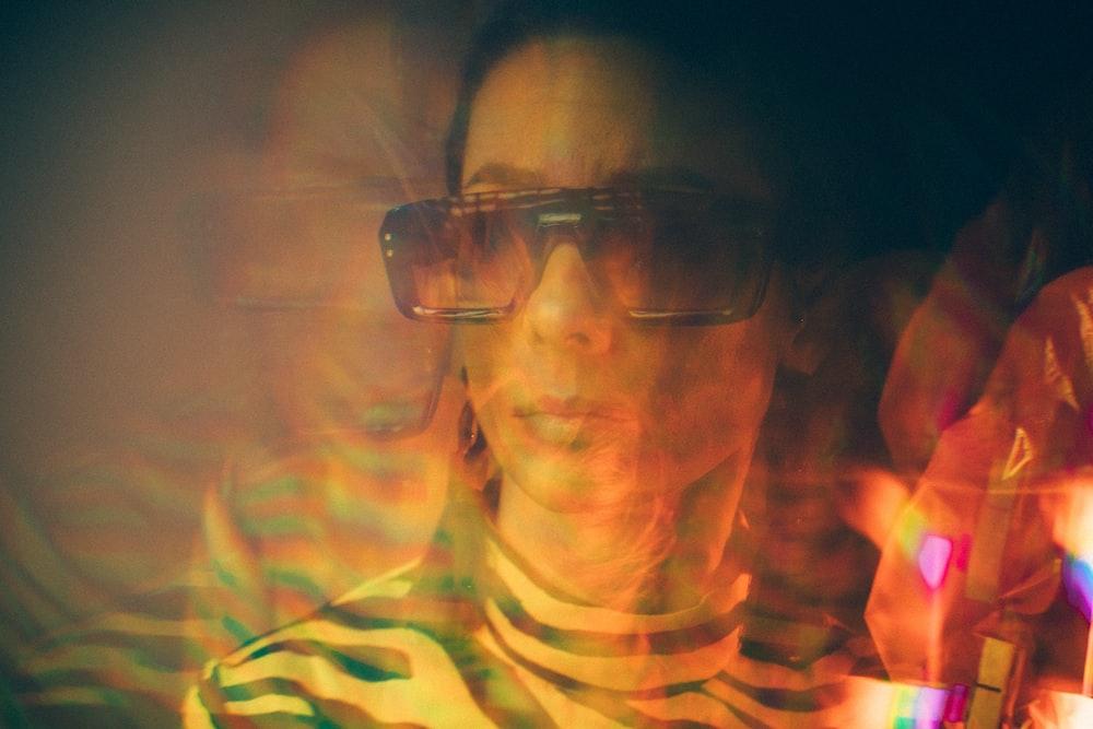 woman wearing sunglasses painting