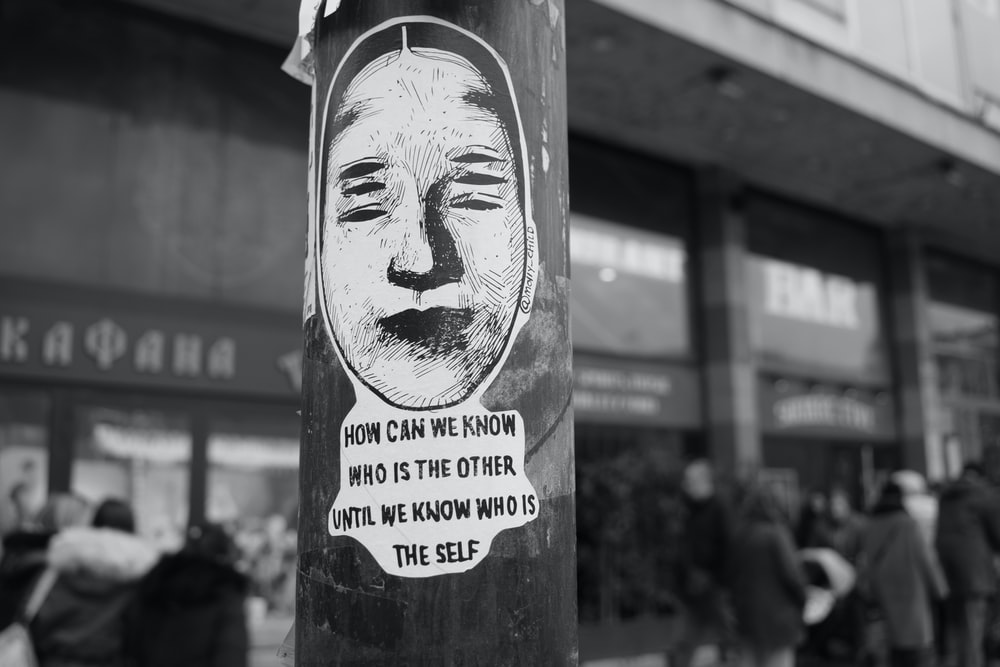 white man with quote post sticker