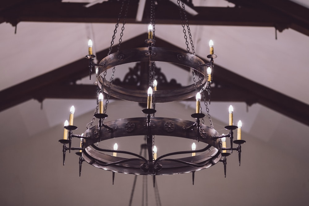 shallow focus photo of uplight chandelier