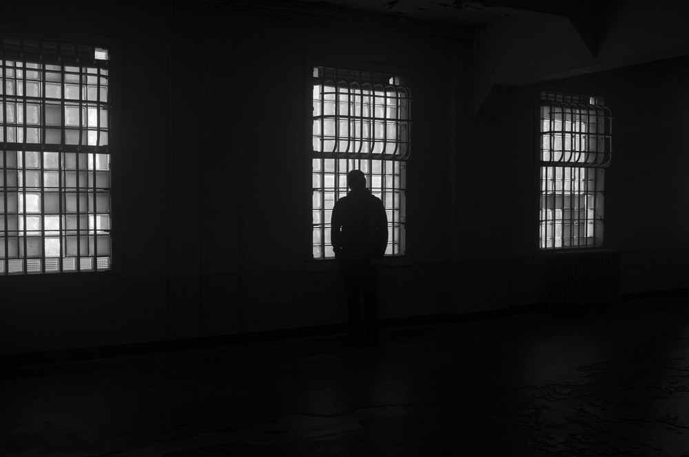 silhouette of person in front of window