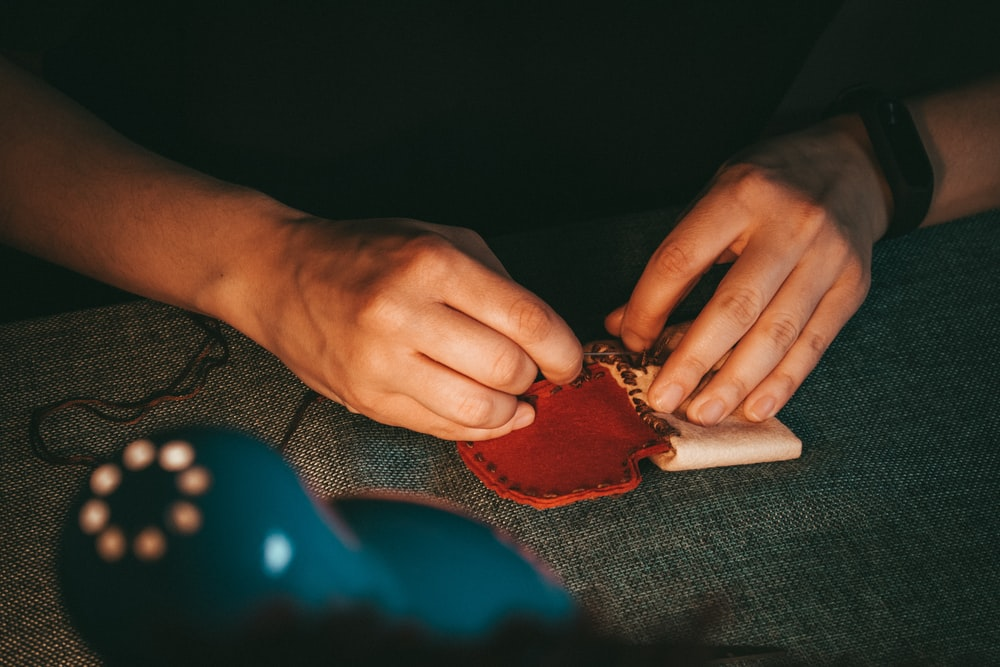person holding leather pouch