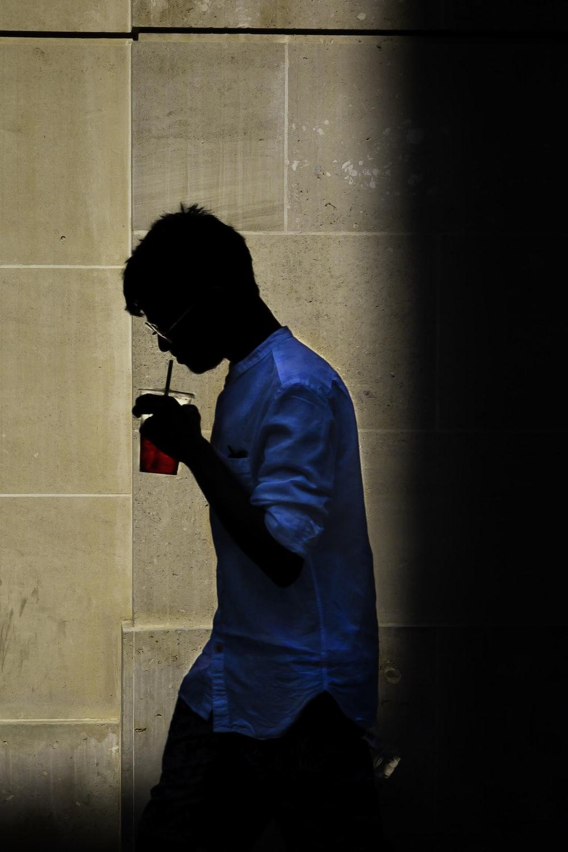 man wearing blue button-up shirt