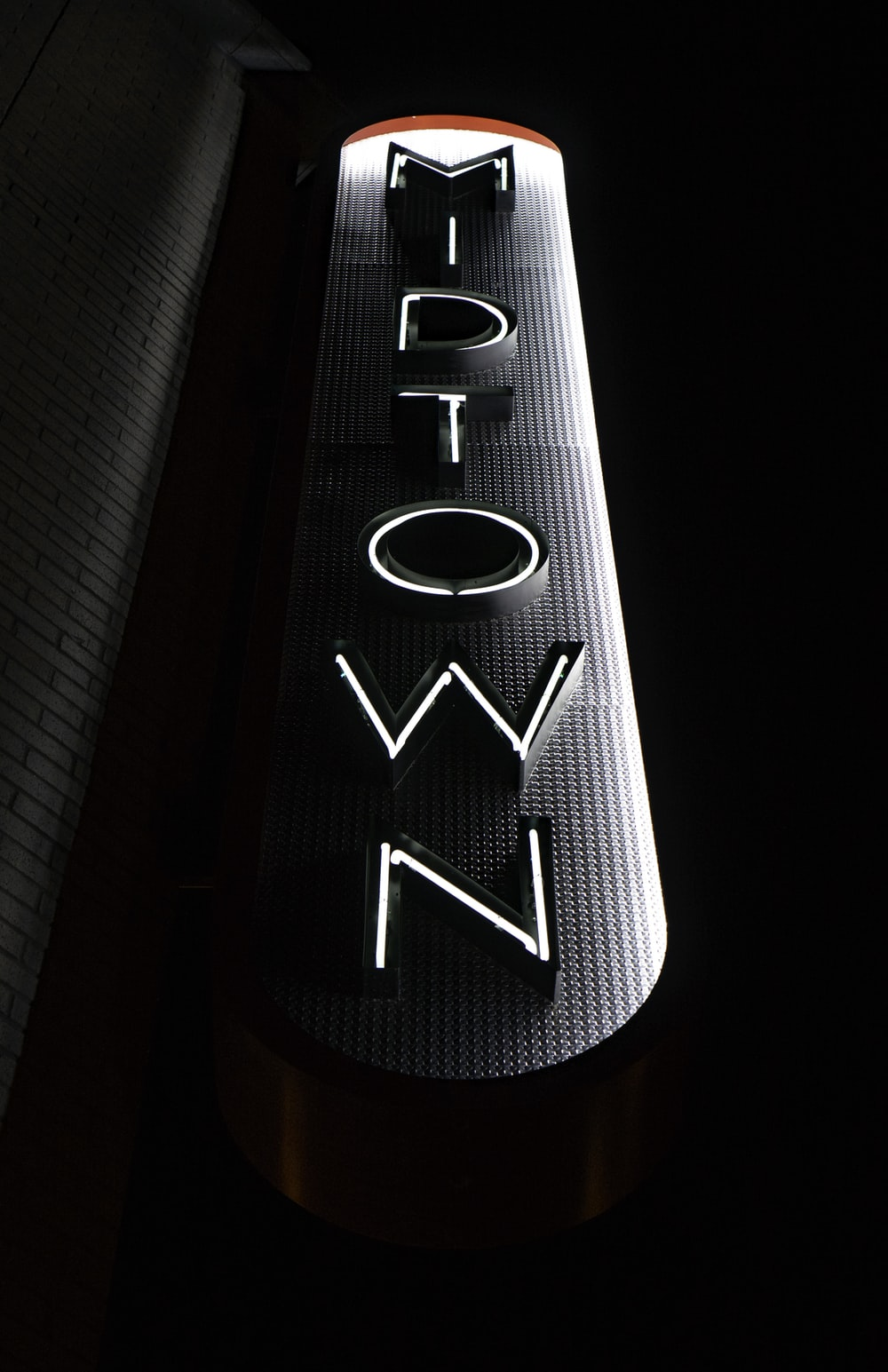 white and grey Midtown neon sign