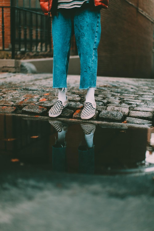 person waering blue jeans