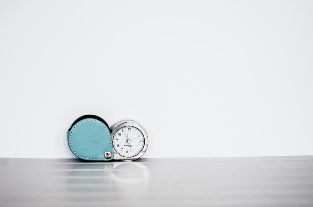gray and white table clock