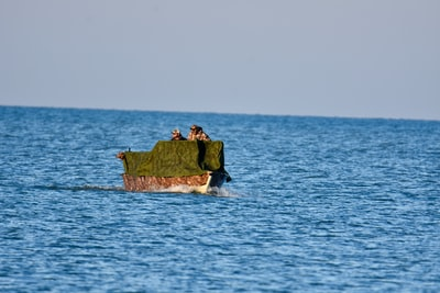 green and brown boat on body of water during daytime indiana zoom background