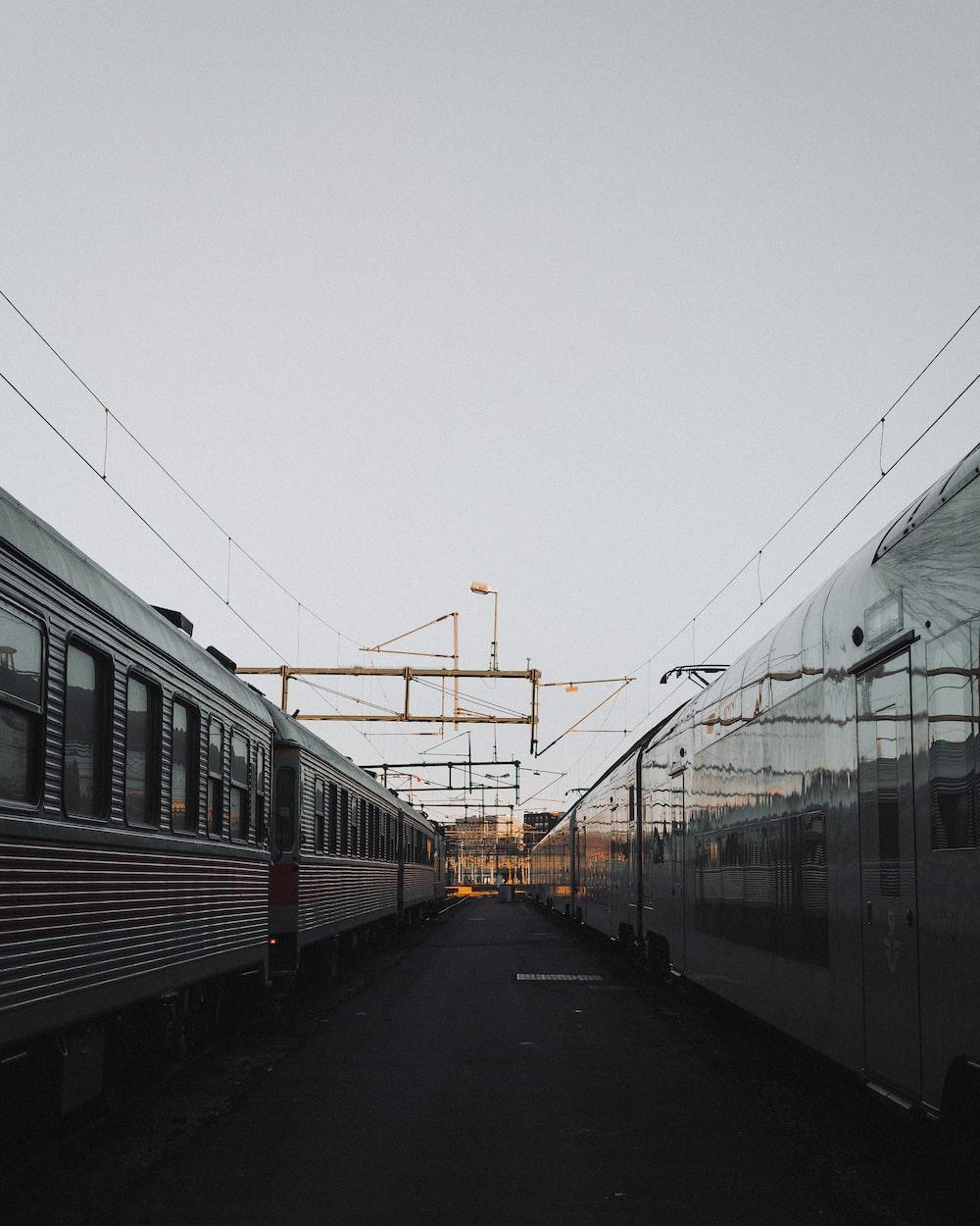 two gray passenger trains