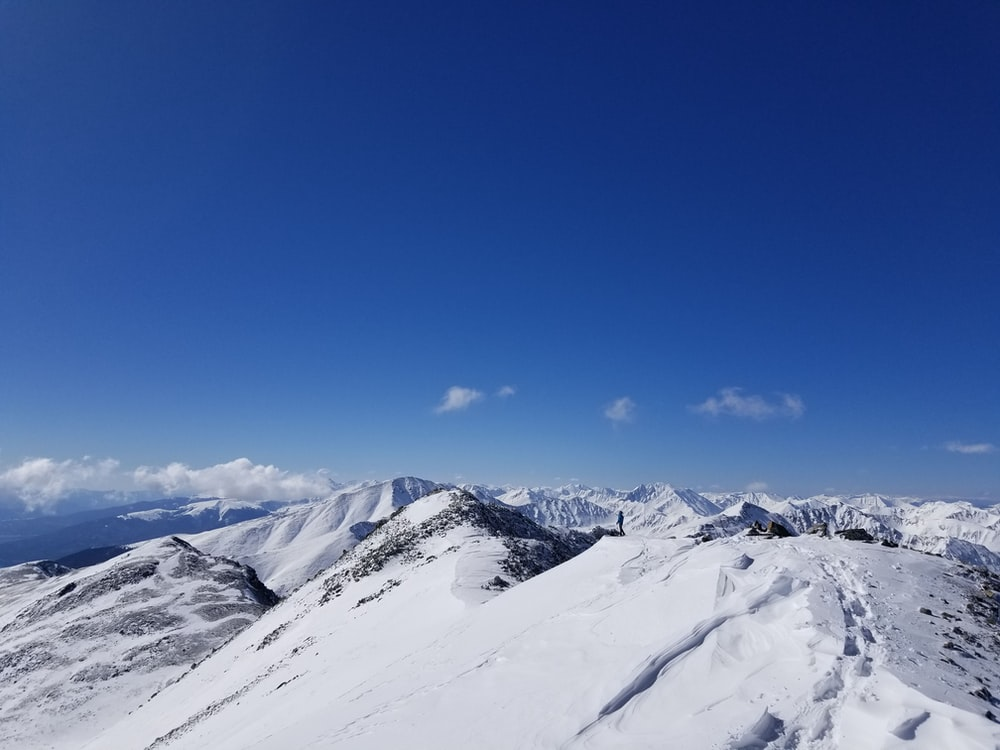 snow capped mountain under blue sky