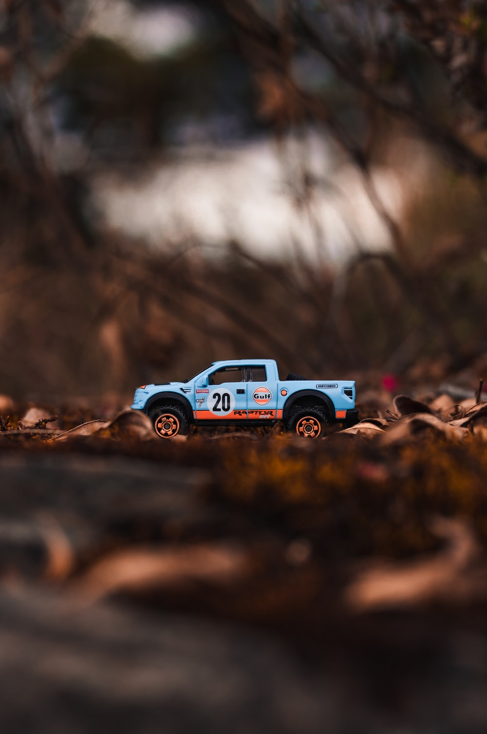 blue truck scale model on ground