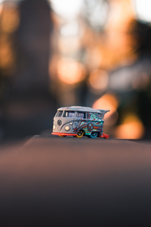 white Volkswagen bus die-cast metal car