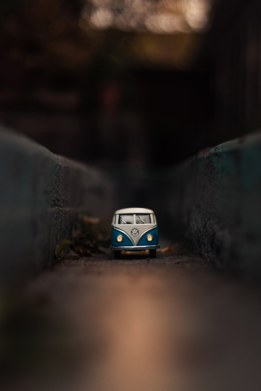 selective focus photo of white and teal Volkswagen T1 die-cast metal scale model