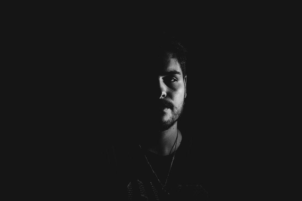 low light portrait photography of man