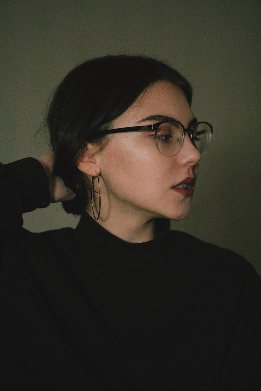 woman wearing black turtleneck top
