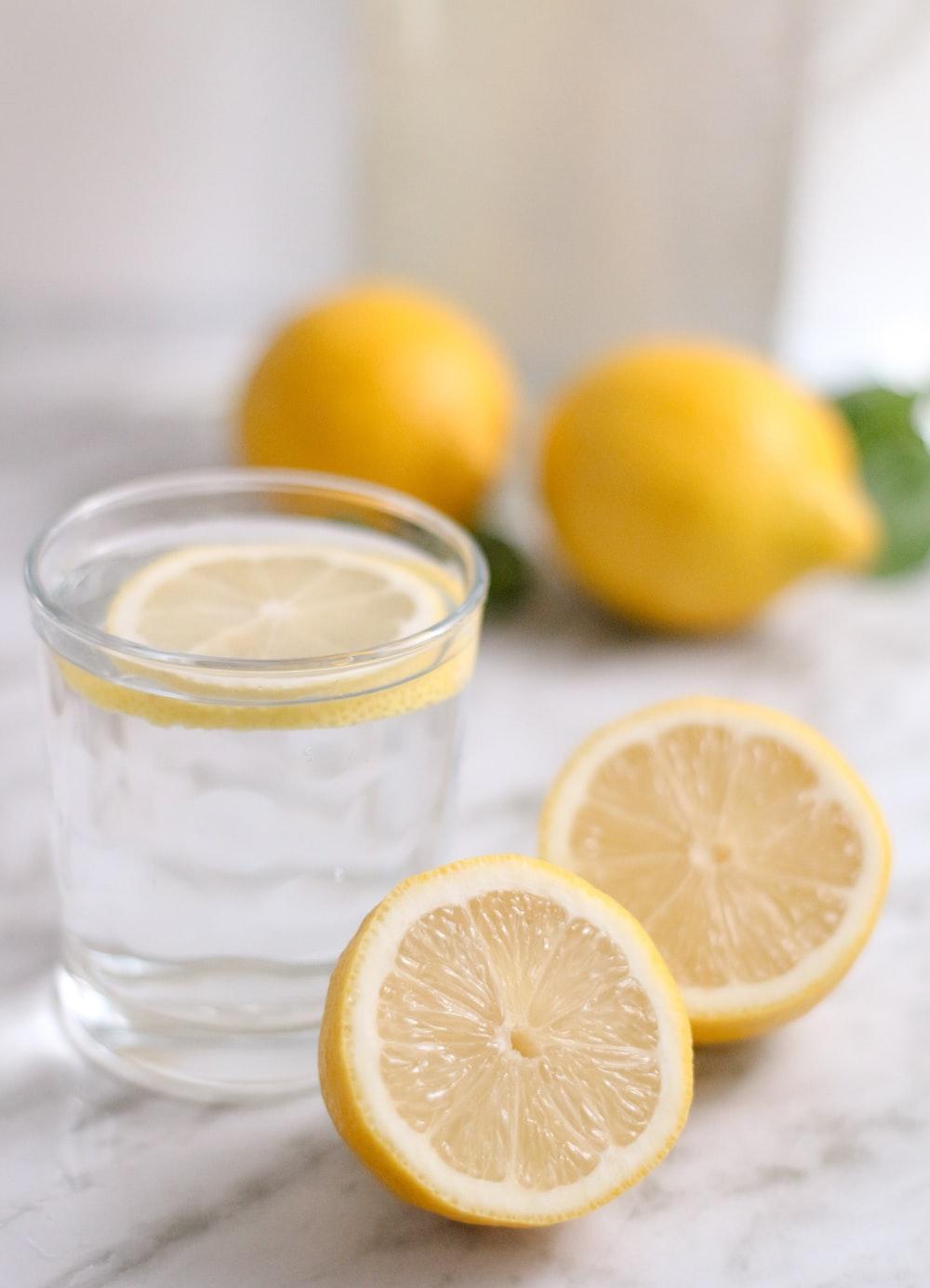 slice lemon beside cup