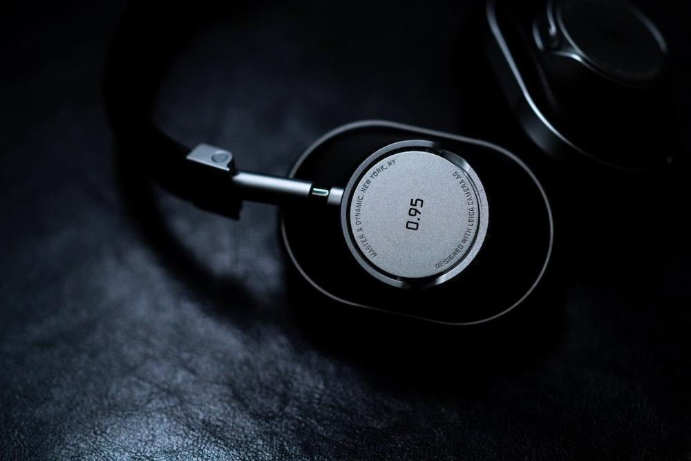 black and grey 0.95 headphones