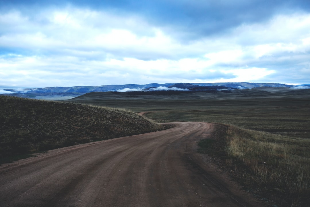 Lone, open dirt road through the Colorado high country.
