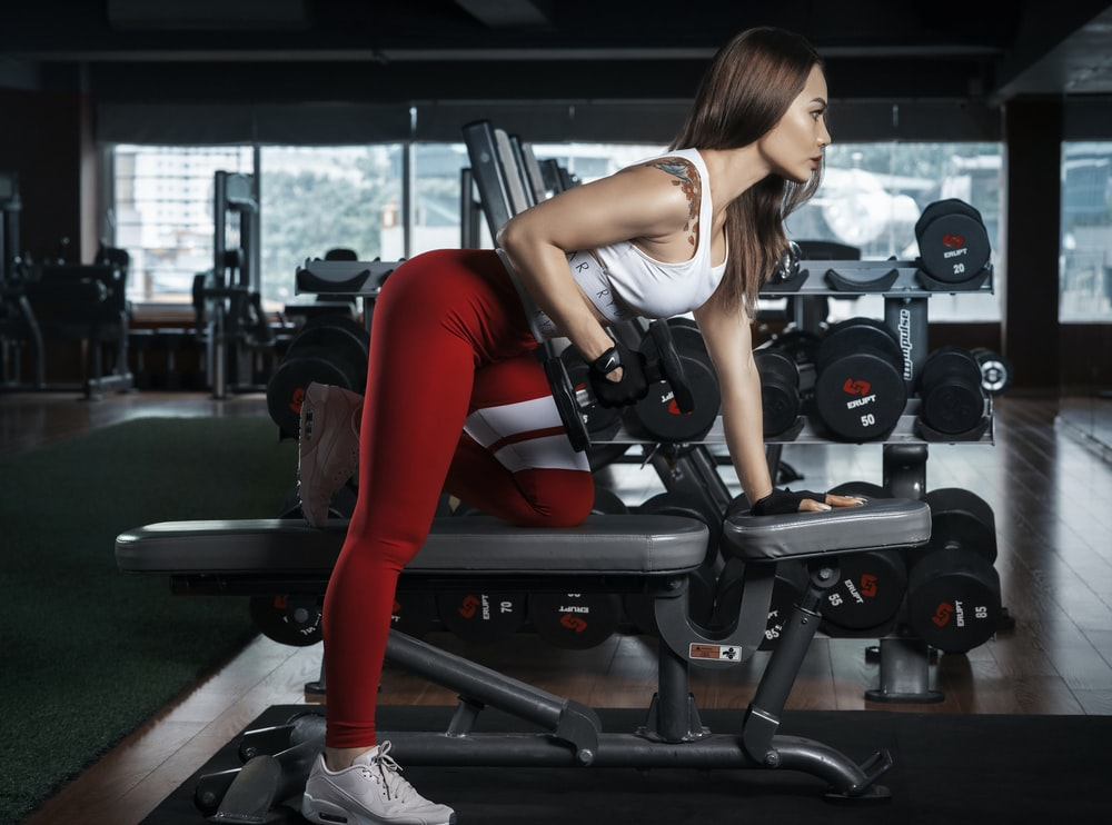 woman using dumbbells