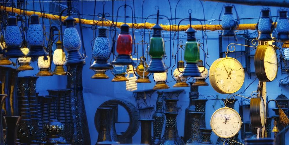 lantern and clock hangs wallpaper