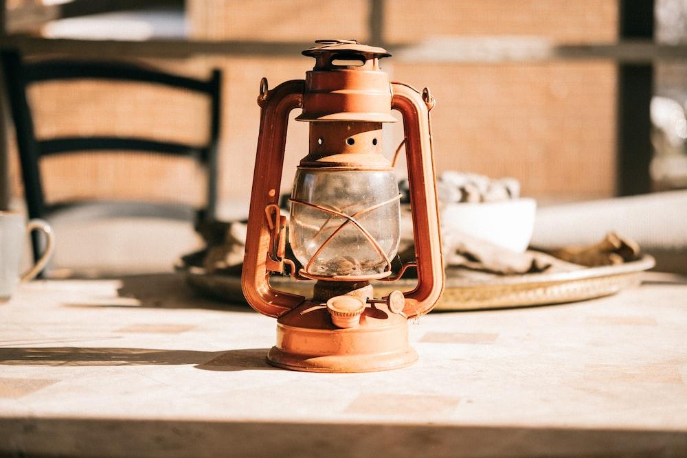 kerosene lamp on wooden table