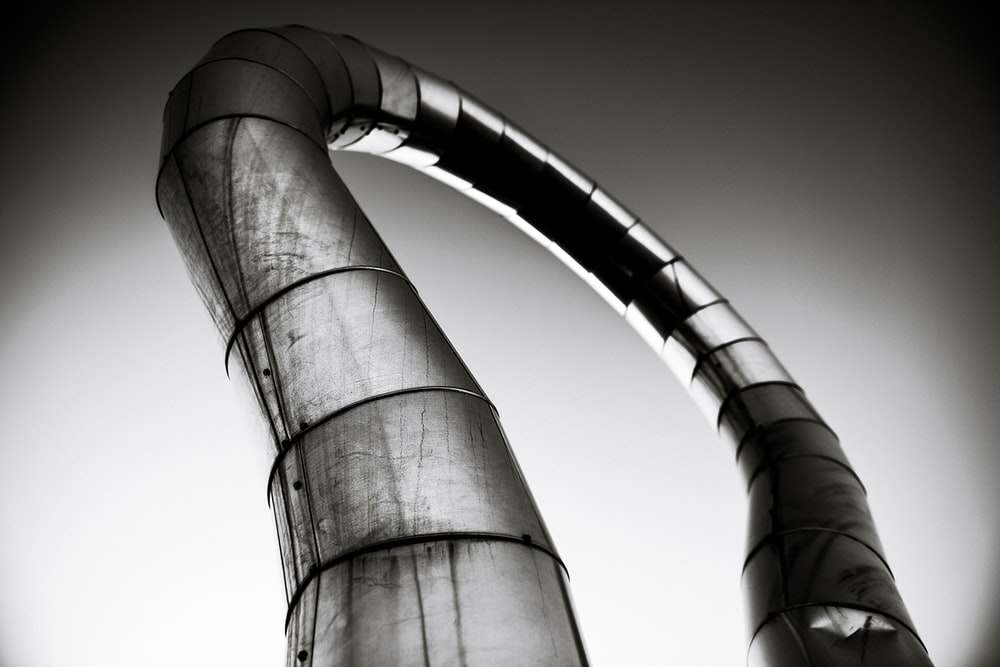 greyscale photo of pipe