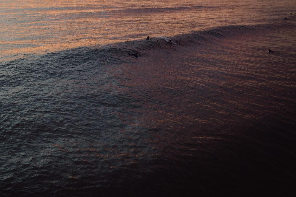 few people on body of water